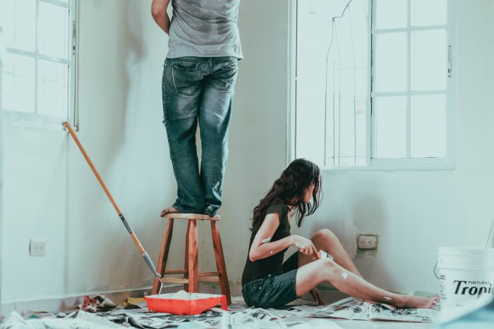Couple painting a new home